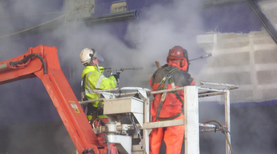 Side of a ship having Ultra High-Pressure Water Blasting (UHP)